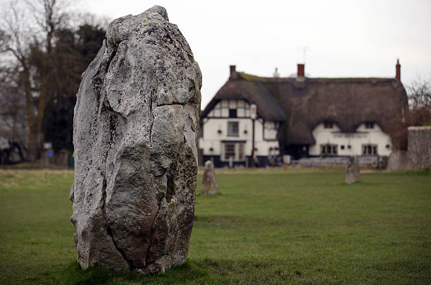 The Red Lion Public House Is Seen Beyond Neolithic Stones At Avebury On February 7