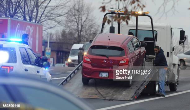WESTMINSTER CO NOVEMBER 2 The red Mitsubishi driven by Walmart shooting suspect Scott Ostrem is loaded on a tow truck after he was arrested near the...