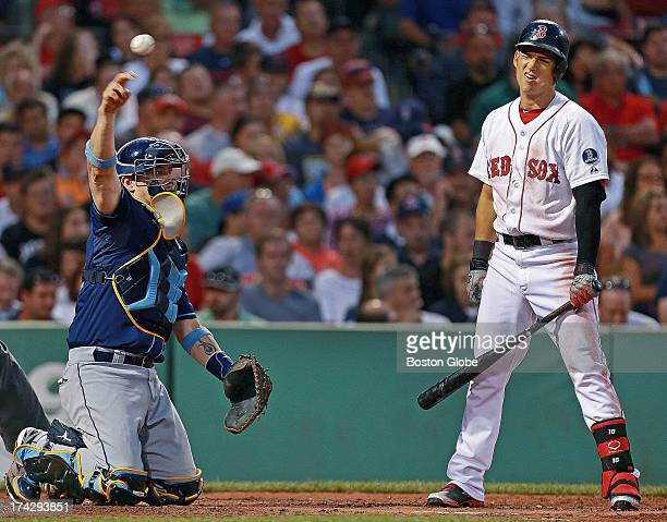 The Red Sox's Jose Iglesias reacts after a called second strike on a pitch from Rays starter Matt Moore as Tampa Bay catcher Jose Lobaton tosses the...