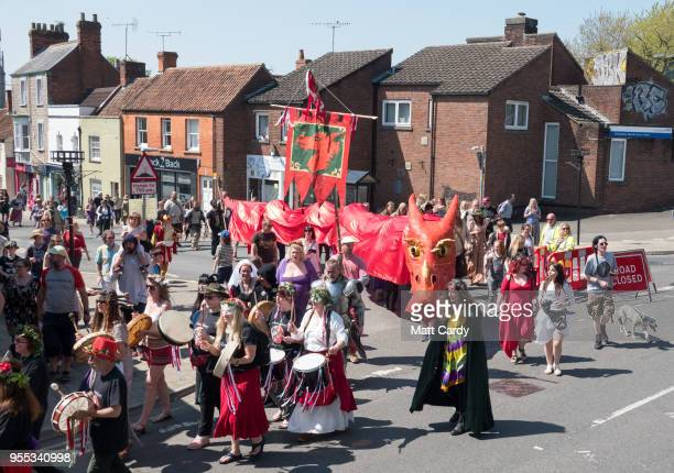 The red summer dragon one of the two Glastonbury Dragons is paraded through the town as they take part in May Fayre and Dragon Procession in...