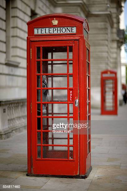 The red telephone box a public telephone kiosk designed by Sir Giles Gilbert Scott is a familiar sight on the streets of the United Kingdom despite a...