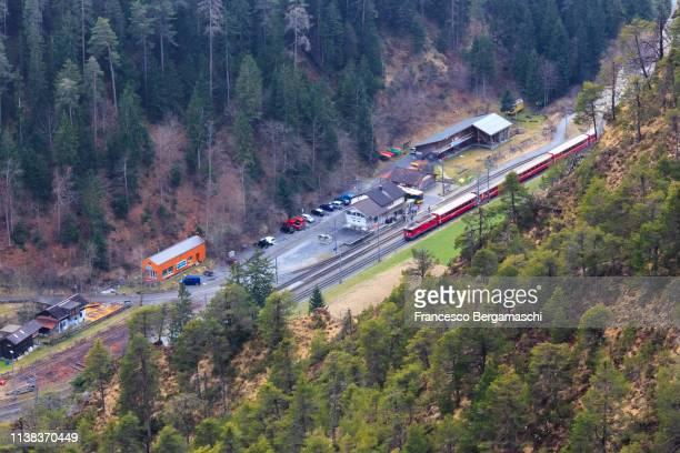 The Red Train makes a stop at Versam-Safien station. Rhein Gorge(Ruinaulta), Flims, Imboden, Graubunden, Switzerland, Europe