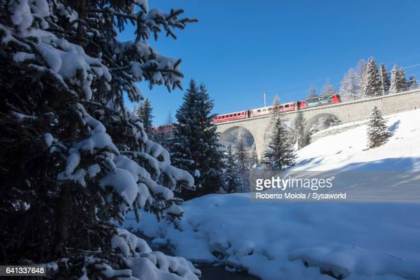 The red train on Chapella Viadukt Switzerland
