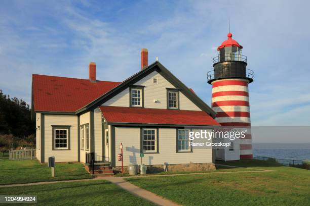 the red-and-white striped west quoddy head lighthouse in maine - rainer grosskopf stock pictures, royalty-free photos & images