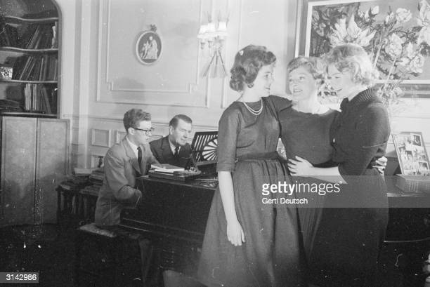The Redgraves first family of British theatre enjoy an evening at their London home Corin and his father Michael double up on the piano whilst Lynn...