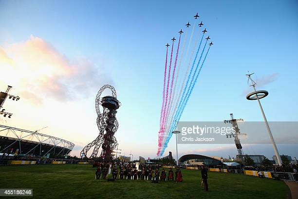 The Reds Arrows RAF Display Team fly over the Orbit at the Queen Elizabeth II Park during the Invictus Games Opening Ceremony on September 10, 2014...
