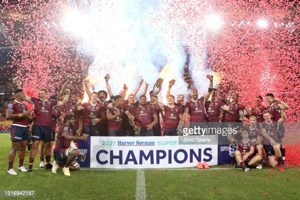 The Reds celebrate with the trophy after winning the Super RugbyAU Final match between the Queensland Reds and the ACT Brumbies at Suncorp Stadium,...