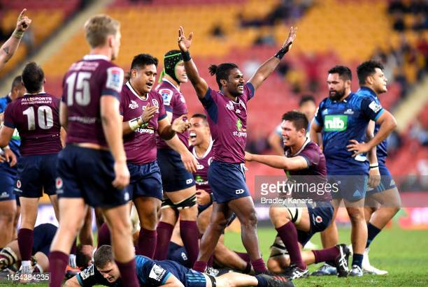 The Reds players celebrate victory after the round 17 Super Rugby match between the Reds and the Blues at Suncorp Stadium on June 07, 2019 in...