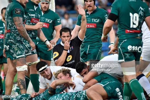 The referee accepts a try for Agen' player Jake McIntyre during the French Top 14 rugby union match between SU Agen and Pau on September 23 2017 at...