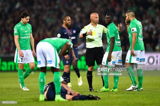 The referee Amaury Delerue give a yellow card to Henri Saivet of Saint Etienne during the Ligue 1 match between AS Saint Etienne and Paris Saint...