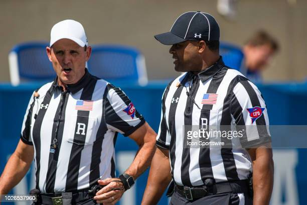The Referee and another judge talking during a college football game between the Central Michigan Chippewas and the Kentucky Wildcats on September 01...