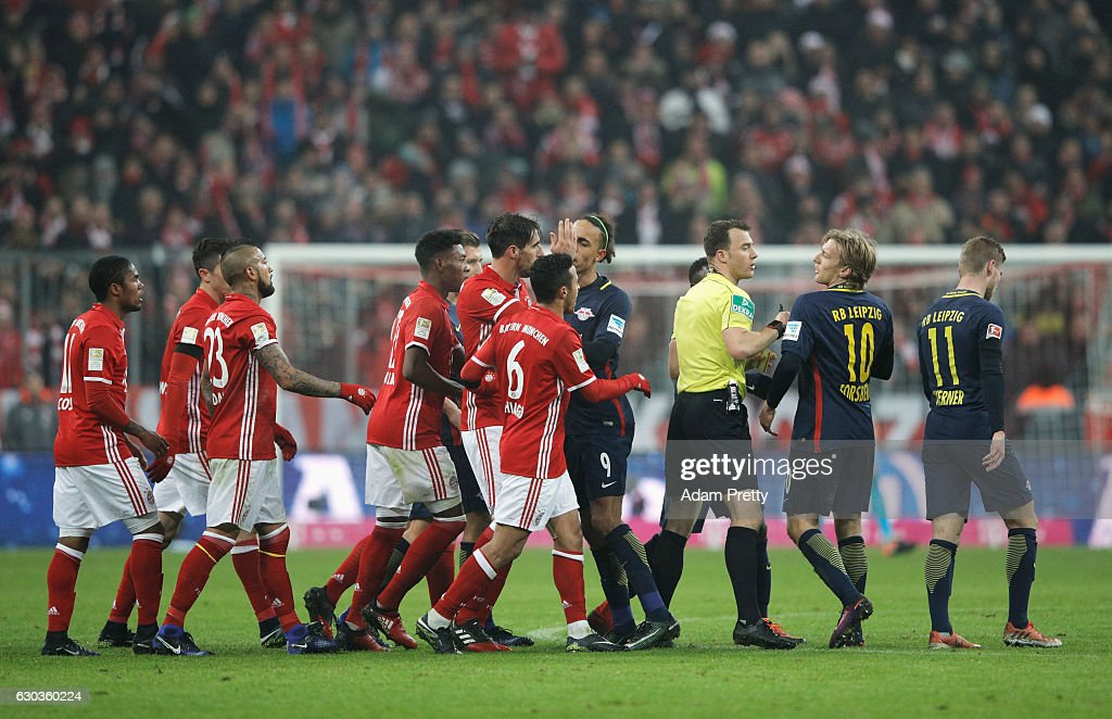 The referee and Emil Forsberg of RB Leipzig (CR) argue during the Bundesliga match between Bayern Muenchen and RB Leipzig at Allianz Arena on December 21, 2016 in Munich, Germany.