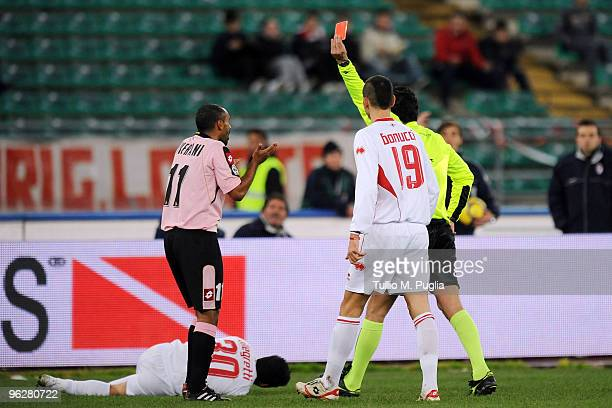 The referee Andrea De Marco shows a red card to Fabio Liverani of Palermo during the Serie A match between Bari and Palermo at Stadio San Nicola on...
