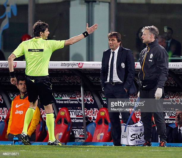 The referee Antonio Damato ejects Antonio Conte head coach of Juventus during the Serie A match between Calcio Catania and Juventus at Stadio Angelo...