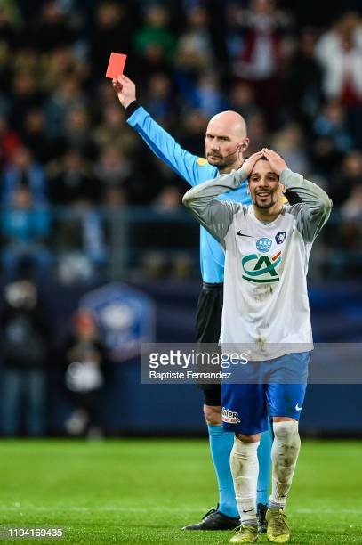 the referee Antony GAUTIER shows a red card to Nessemon William SEA of Granville during the French Cup Soccer match between US Granville and...