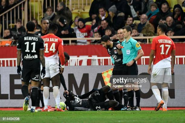 The referee Benoit Bastien gives a red card to Keita Balde of Monaco during the Ligue 1 match between AS Monaco and Lyon at Stade Louis II on...