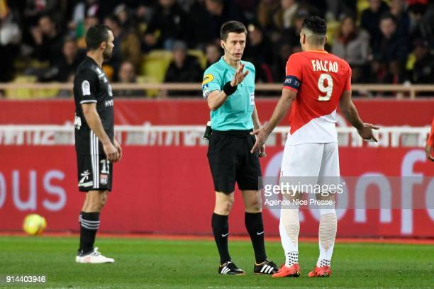 the referee Benoit Bastien with Falcao of Monaco during the Ligue 1 match between AS Monaco and Lyon at Stade Louis II on February 4 2018 in Monaco