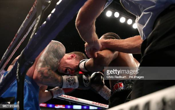 The referee breaks up Anthony Yarde and Darius Sek during the WBO Intercontinental European LightHeavyweight Championship at The O2 London