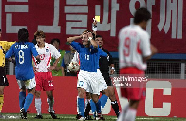The referee Byron Moreno gives the second yellow card to Francesco Totti of Italy during the South Korea v Italy, World Cup Second Round match played...