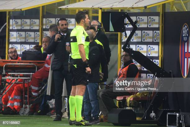 the referee check the VAR prior to give a penalty kick to FC Crotone during the Serie A match between Bologna FC and FC Crotone at Stadio Renato...
