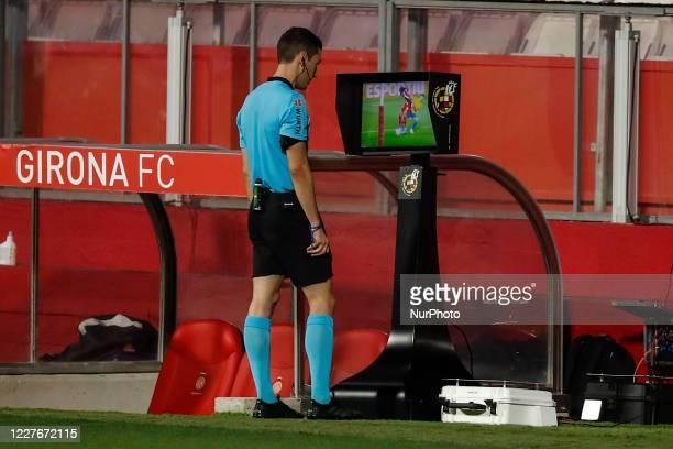 The referee checking the VAR during La Liga Smartbank match between Girona FC and Cadiz CF behind closed doors due to Coronavirus at Montilivi...