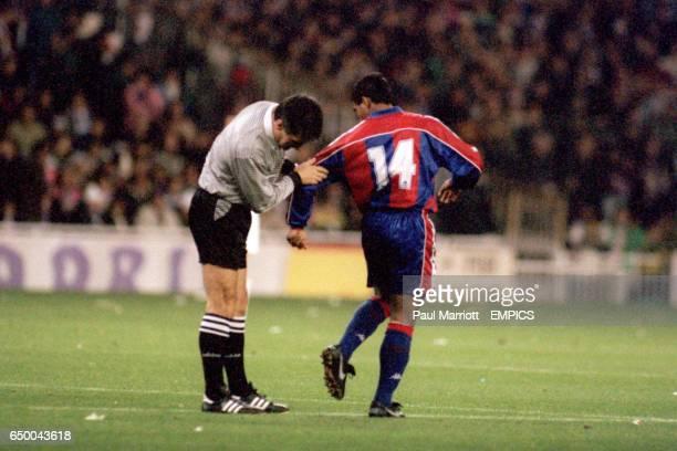 The referee checks the boots of Barcelona's Romario