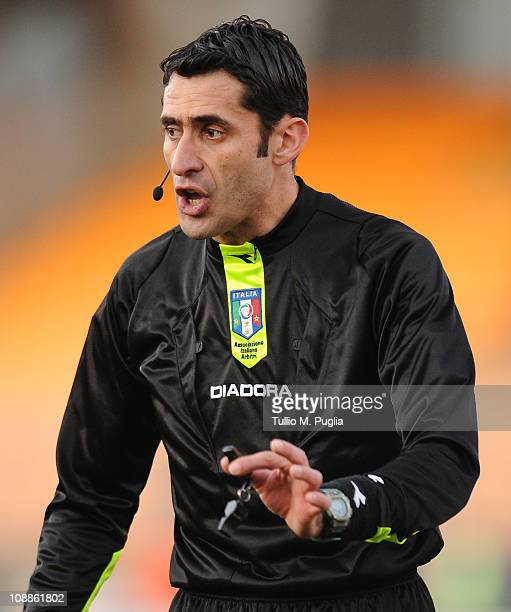 The referee Christian Brighi gestures during the Serie A match between US Lecce and US Citta di Palermo at Stadio Via del Mare on February 6 2011 in...