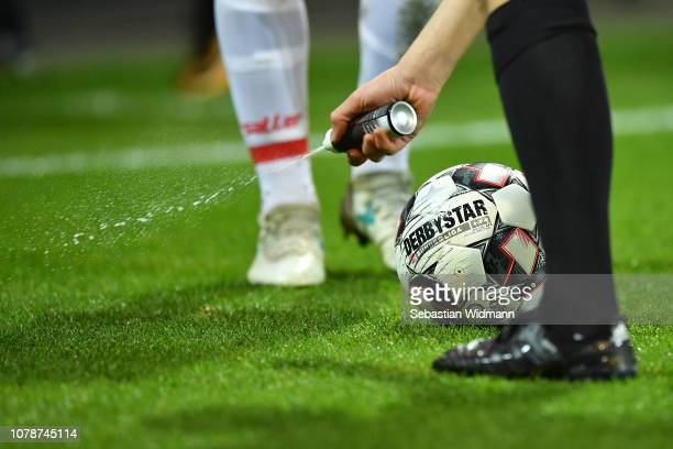 The referee Christof Guensche sprays foam next to the match ball on the pitch during the Second Bundesliga match between SSV Jahn Regensburg and 1....