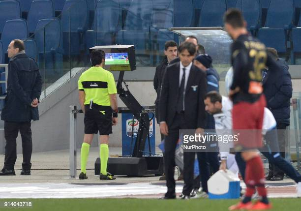 the referee consult VAR during the Italian Serie A football match between SS Lazio and Genoa at the Olympic Stadium in Rome on february 05 2018