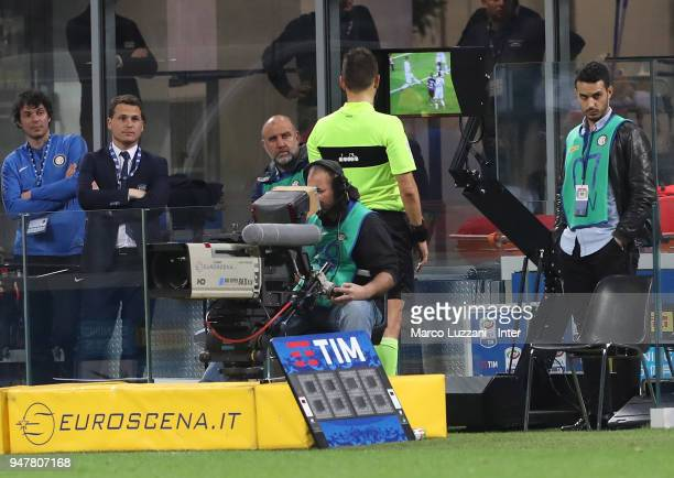 The referee consults the VAR during the serie A match between FC Internazionale and Cagliari Calcio at Stadio Giuseppe Meazza on April 17 2018 in...