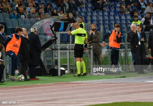 the referee consults the VAR monitor during the Italian Serie A football match between SS Lazio and Cagliari at the Olympic Stadium in Rome on...
