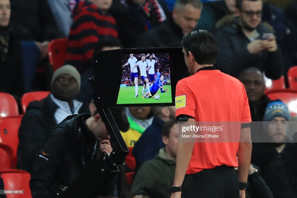 The referee consults VAR before awarding a penalty to Italy during the International Friendly match between England and Italy at Wembley Stadium on March 27, 2018 in London, England.