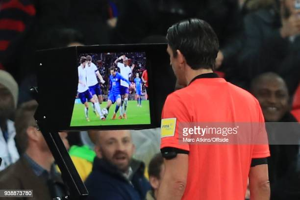 The referee consults VAR before awarding a penalty to Italy during the International Friendly match between England and Italy at Wembley Stadium on...