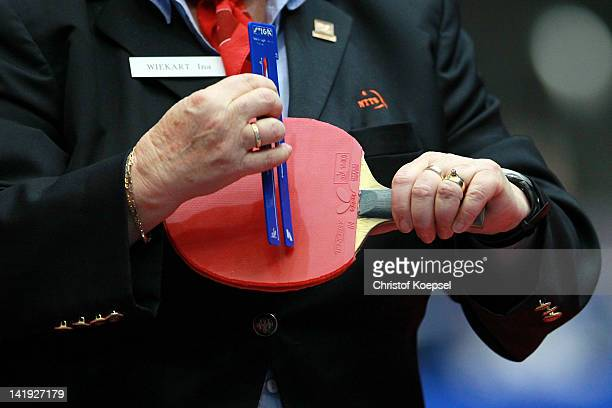 The referee controls the rubber of the racket during the LIEBHERR table tennis team world cup 2012 championship division group B men's team match...
