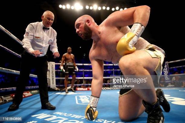 The referee counts Nathan Gorman out as Daniel Dubois looks on during the British Heavyweight Title fight between Daniel Dubois and Nathan Gorman at...
