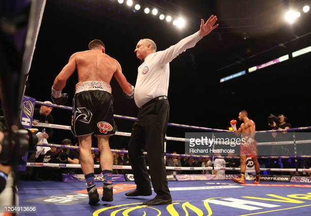 The referee counts out Mark DeLuca as Kell Brook celebrates victory during the WBO Intercontiental Super-Welterweight Title Fight between Kell Brook...