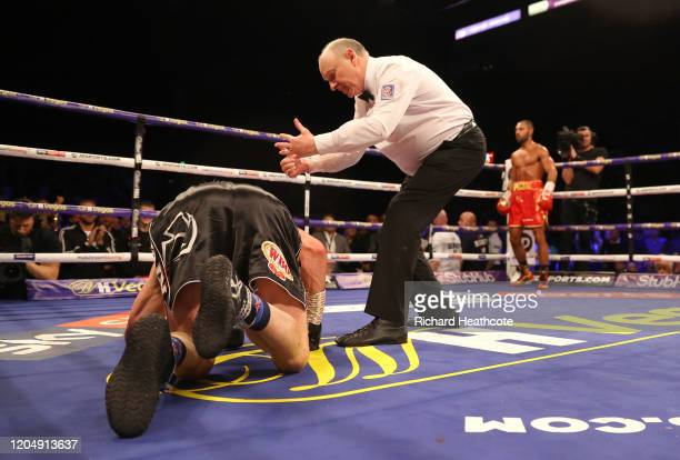 The referee counts out Mark DeLuca as Kell Brook waits in the corner during the WBO Intercontiental SuperWelterweight Title Fight between Kell Brook...