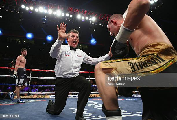 The referee counts out Wayne Reed of Sheffield as Rocky Fielding ofLiverpool looks on during the English SuperMiddleweight title fight at the Echo...
