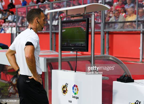 The referee Cuadra Fernandez checks the VAR system prior to the La Liga match between Girona FC and Real Valladolid CF at Montilivi Stadium on August...