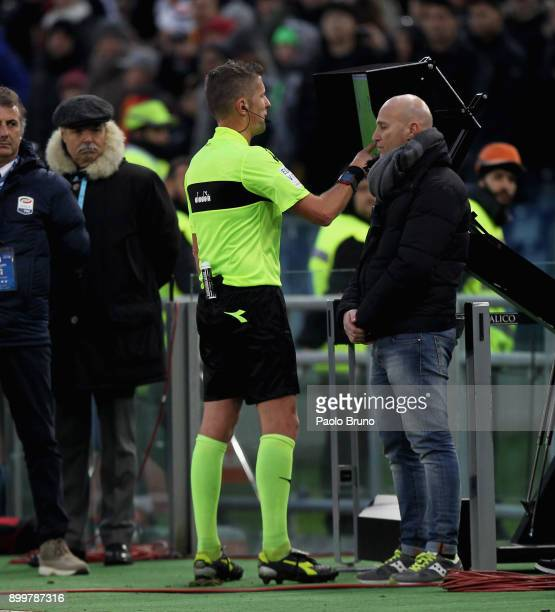 The referee Daniele Orsato is checking the VAR during the serie A match between AS Roma and US Sassuolo at Stadio Olimpico on December 30 2017 in...