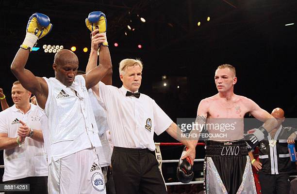 The referee declares French Souleymane Mbaye winner of his light-welterweight European champion boxing fight against British Colin Lynes , on July 3,...