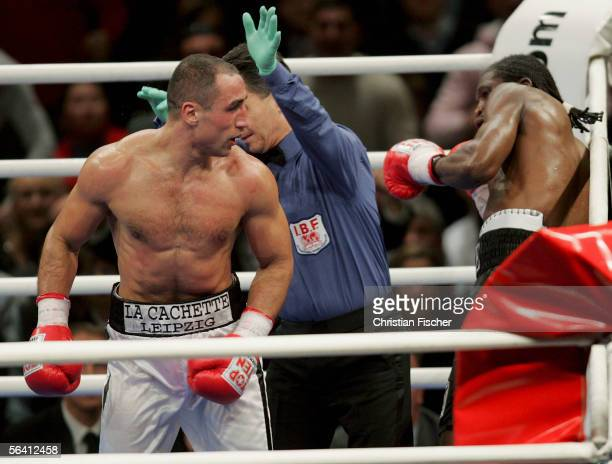 The referee ends the fight during the IBF World Championship middleweight fight between Arthur Abraham of Germany and Kingsley Ikeke of Canada at the...
