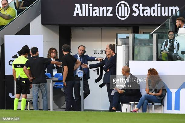 The referee Fabio Maresca look at the VAR monitor to concede a penalty for Cagliari during the Serie A match between Juventus and Cagliari Calcio at...