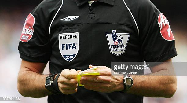 The Referee FIFA 2010 and FA Premier League badges on the shirt of Premiership referee Mark Clattenburg