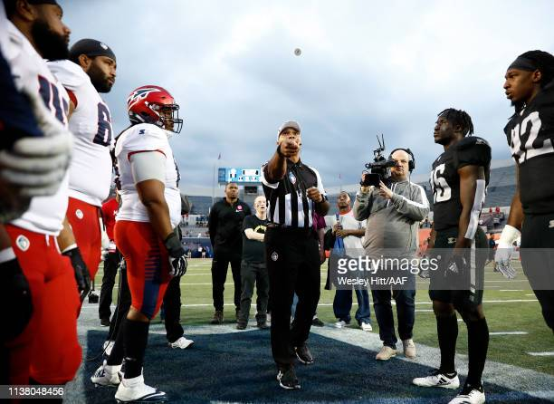 The referee flips the coin for the coin toss before the Memphis Express take on the Birmingham Iron during their Alliance of American Football game...