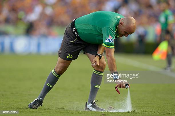 The referee Francisco Chacon marks a line on the pitch with spray foam during a 3rd round match between Tigres UANL and Chivas as part of the...