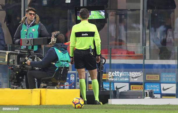 The referee Gianluca Rocchi is checking the VAR during the serie A match between FC Internazionale and SS Lazio at Stadio Giuseppe Meazza on December...