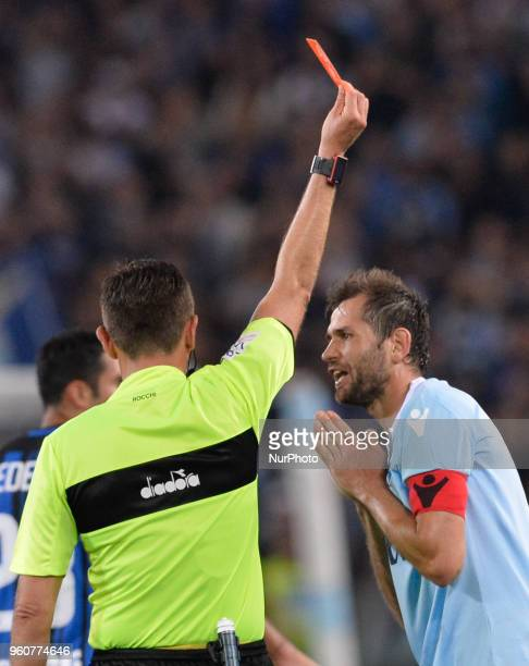 The referee Gianluca Rocchi show the red card to Senad Lulic during the Italian Serie A football match between SS Lazio and FC Inter at the Olympic...