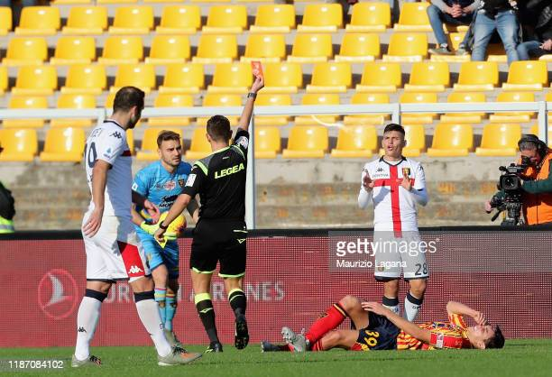 The referee Gianluca Rocchi shows the red card to Kevin Agudelo of Genoa during the Serie A match between US Lecce and Genoa CFC at Stadio Via del...