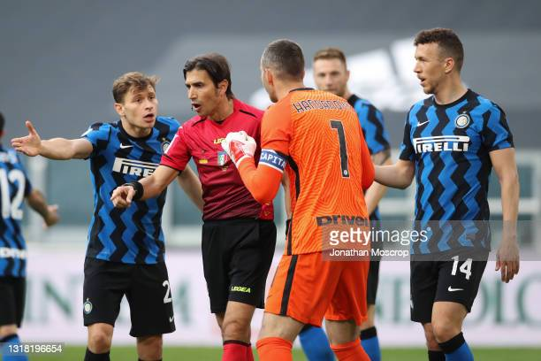 The referee Gianpaolo Calvarese points to the penalty spot as Nicolo Barella, Samir Handanovic and Ivan Perisic of Internazionale protest against the...